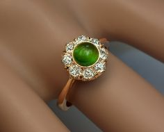 A Cat's Eye Demantoid Garnet and Diamond Cluster Ring The demantoid and diamond cluster is circa 1890, and the shank is a modern replacement (14K gold). Th