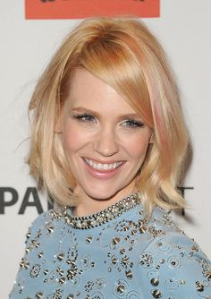 January Jones attended PaleyFest 2012 wearing her bobbed hair in tousled waves with candy pink streaks.  Tip: Want funky highlights like these? We love Streekers temporary hair color ($11.95 at Colormetrics.com) because the pigments are truly temporary and come out in one wash.