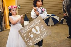 The ring bearer and flower girl announce the bride with this sweet sign