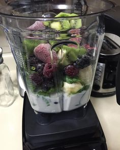 Morning bliss in the making. 2 cups of unsweetened Califia almond milk 2 organic ripe banana 1 ripe organic kiwi 1 cup organic berries and 2 cups of organic spinach. #Organic #Blueberries #Strawberries #Blackberries #Banana #SimplyGreenSmoothies #Kiwi #Vitamix7500 #FitLife #Lemon #CalifiaAlmondMilk #EatClean #CleanFood #Blending #Cyclist #MasonJar #Breakfast #SpinningInstructor #Marathoner #Runner #Celiac #Vegan #Spinach #SuperFood #CleanEating #GlutenFree by poshcyclist_
