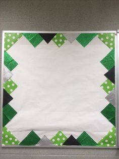 Bulletin board with school colors border. Add athletic schedules, news paper clippings, mascot posters, etc. Start with corners first. Cute with blue and white to fit school colors.