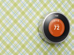The Nest Learning Thermostat's chameleon design reflects the wall around it.