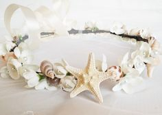 This beautiful sea shell studded beach wedding flower crown begins with a coated brown floral wire which resembles a natural twig or small branch.