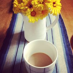 Beautiful cloth from Maranghouse http://www.etsy.com/shop/Maranghouse with calendula from the market and my morning coffee in my Norman Copenhagen Mormor cup