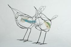 I love the sketchy look to these wire birds by Jill Walker, and how she has added pieces of fabric into the design to create points of interest and imitate the plumage.