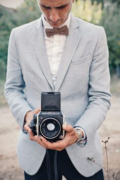Groom and old-fashioned camera - Read More - http://onefabday.com/french-wedding-by-marianne-taylor/