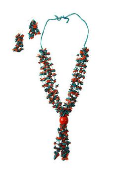 Teal Long Melon Seed Set, Colombia - Necklace and earring set. Necklace features multicolored dried melon seeds hand-woven onto red cord, with a bright red or neutral acai seed. Slip-knot closure allows for length to be adjusted slightly. Earrings match necklace with large cluster of seeds. Handmade by a cooperative of women in Colombia working together to sustainably harvest, dry and hand-color indigenous seeds to create unique jewelry.