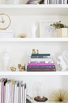 Gold tchotchkes done right. DIY built-in shelves // home update // smitten studio