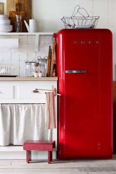 Vintage Appliances - CountryLiving.com - this gorgeous red refrigerator, would liven up any style of kitchen
