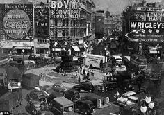 Photo of Piccadilly Circus, London showing the statue of Eros in its old location.