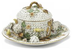 A Meissen 'Schneeballen' tureen, cover and stand  Late 19th Century, blue crossed swords marks  Applied all over with blossom, blossom clusters, trailing roses and birds perched on trailing leafy vines, with applied gilt leaves and canaries, some damage