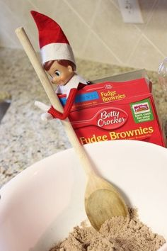 Elf making brownies with a note written to the kids asking to help finish making the brownies by cracking eggs. :)