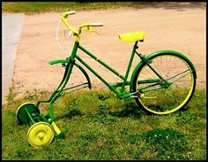 John Deere colored bicycle lawn mower