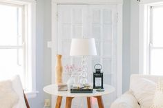 @Alaina Marie Kaczmarski Chicago Apartment Tour // living room // side table // white // photography by Stoffer Photography