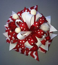 Red and White Christmas Hair Bow with fun accents. on Etsy, $10.00 check out my moms hair bow shop she can also do special orders.