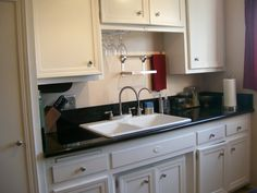 Small Galley Kitchen, Black Galaxy Granite, white cabinets, Ikea Grundtal shelves. , Small Galley Kitchen. Entire make over was under $3000....