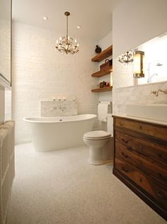 WHITE & wood! The tiles on the floor are marble – little sugar-cube sized sparkly mosaic squares (Tub, tiles and most of the fixtures are from Ciot) The sink & Toilet is by Porcher. The paint colour is Genesis White by Benjamin Moore. Wall sconces are from Restoration Hardware,
