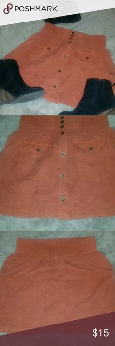 Super cute chill skirt! Life in progress... size XS Brand new never worn skirt! Tags are not still on it but it has never been worn. In great condition! Rust orange with brown buttons, you CAN use pockets woo! And unbutton the front for frill! Would look really cute with black polkadot sheer tights and a sexy fitting black top for a fun edgy night out!   ?Fast shipping!! ?5 star rated seller!! ?Unique packaging every buy!! ?Bundle discounts!! life in progress  Skirts
