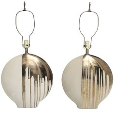 Italian Ceramic Table Lamps with Mettalic Dripping Glaze  Italy  1960's  These oversized pill shaped table lamps with metallic dripping glaze are extremely unique and artistic.
