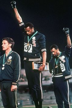 """The black power salute at the 1968 Olympics was a protest made by the African American athletes Tommie Smith and John Carlos; the athletes made the raised fist gesture at the Olympic Stadium in Mexico City. """"The Silent Gesture"""""""