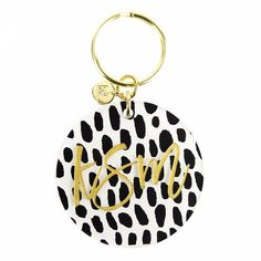 Patterned monogram keychain in a script font. This acrylic key ring is a unique everyday essential. Choose from three hand-drawn prints or a b/w striped print.