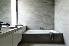 Family bathing at its best.  Tiles by KWD.  Incredible bathroom design by @cannygroup.