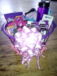 14 year old birthday purple themed gift basket. Nail polish, remover. Nail Clippers. Nail file and buffer. Socks. Make up remover wipes. Hair ties. Candy :) for my girl La'Veda