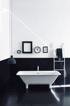 black and white bathroom. Also industrial pipes painted white for towel rack.