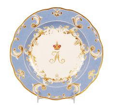 A Russian Imperial Porcelain Factory dinner plate from The Farm Palace Banquet Service, a Service made for Grand Duke Alexander Nikolaevich (Alexander II) during the reign of his father Nicholas I, Peterhof, circa 1825-1855. The center of the plate decorated with the crowned Imperial cipher of Alexander II against a powder blue ground.