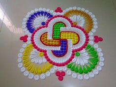 How to make beautiful innovative multi colour rangoli - Simple Craft Ideas Rangoli Designs Latest, Latest Rangoli, Rangoli Designs Diwali, Diwali Rangoli, Kolam Designs, Indian Rangoli, Rangoli Colours, Rangoli Patterns, Rangoli Ideas