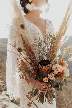 Made from intricate graphic lace, this fitted gown features a plunging v-neckline and dramatic train. The cascading flutter sleeves transform into a gorgeous cape detail to frame the open back. Fall Wedding Flowers, Wedding Colors, Wedding Bouquets, Fall Wedding Arches, Boho Flowers, Fall Bouquets, Dried Flowers, Hippie Style Weddings, Lace Weddings