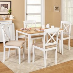 Update your dining area with this stylish five-piece set. This set includes a contemporary rectangular table and four cross-back chairs upholstered in microfiber.