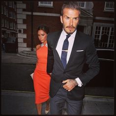 Grey pants, dark jacket, tie bar, pocket square and great cufflinks. David Beckham has an amazing eye for detail.