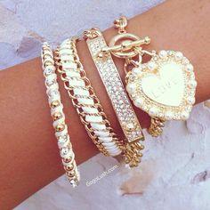 Gold,diamond,and pearl bangle bracelets plus gold heart pearl charm bracelet.