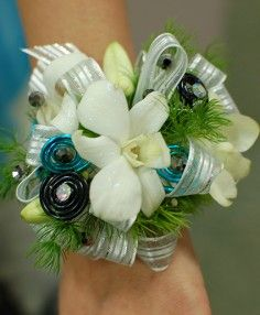White Orchid Prom Corsage  Flowers of Charlotte loves this!  Visit us at flowersofcharlotte.