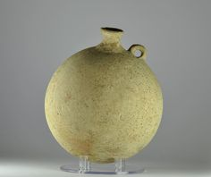 Roman pilgrim flask, 1st century A.D. Eastern Mediterranean Holy land pottery pilgrim flask with one little handle used to carry Holy water from pilgrims, 18.2 cm high. Private collection