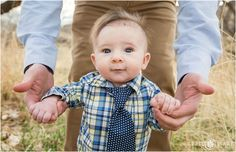 Super sweet 3 month old baby boy wearing a polka dot blue tie at his first professional family photos at Devil's Backbone in Loveland Colorado. - April O'Hare Photography http://www.apriloharephotography.com