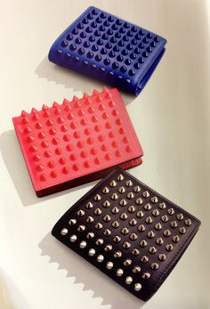 Christian Louboutin leather wallet with spikes in blue sapphire, fluorescent rose and black