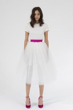Tyler: Short sleeve fitted tee with Swarovski buttons up back.  Shaw: Full short tulle skirt with pink organza waistband  www.houghtonnyc.com