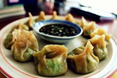 These are not necessarily traditional gyoza, which are Japanese potstickers. Traditionally they are made with shredded cabbage & ground meat. These are little vegan treats made with edamame, ginger & basil...they are creamy on the inside & have a lovely fresh taste. Perfect for this amazing Spring weather.  Gyoza can be fried or steamed, but the technique I used for these little guys I learned from Jamie Oliver's super old show, Oliver's Twist: a quick, shallow fry on the bottom, then a…