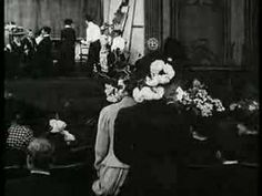 A gentleman with a top hat, and a series of women with ever more ludicrous hats enter a movie theatre. They refuse to remove them, until a giant bucket forcibly removes one hat. All but one woman then remove their hats, and the bucket returns to remove the woman.    Those Awful Hats  (1909) American  B : Split-reel