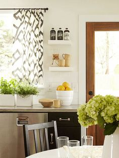 Who says curtains don't belong in the kitchen? Love the pattern and color in here.
