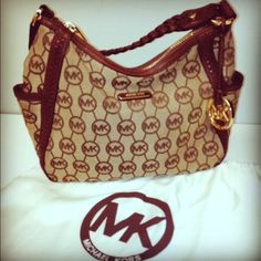 Brown braided leather handle.  2 side pockets and 1 pocket on the back.  Width is 13 inches depth is 7 1/2 inches strap drop is 8 1/2 inches. Gently used. Inside clean 3 additional pockets on the inside of the bag. Zip closure with Michael kors on zipper pull.