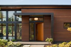 This residence in Olympia showcases a modern design that utilizes an L-shaped floor plan, wall to floor ceiling glazing and radiant floor heating.