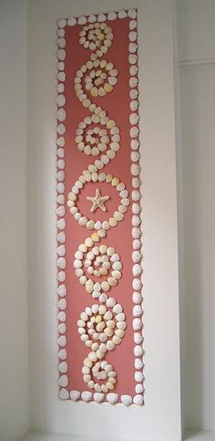 Lovely design on seashell panel; would make a pretty pattern for a garden mosaic.: