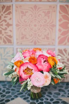 Bold Coral, Orange, and Pink Peony Bouquet | onelove photography | Bold Colors and Modern Sparkle in Palm Springs for a Glam Desert Wedding