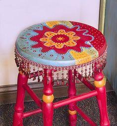 Colorful Boho Stool -- Create a colorful boho stool with beaded fringe. #boho #decoartprojects #chalkyfinish