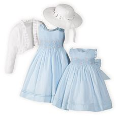 Powder blue dresses of soft poly/cotton organdy. Intricately hand-smocked bodices with shades of pink floral hand-embroidery. Fully lined. Button back