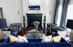 Love the indigo accents and the accent chairs.