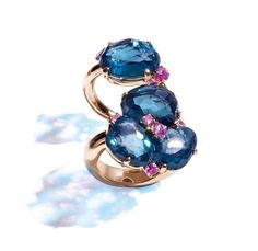 The Bahia Rings, by Pomellato, in London Blue Topaz and Pink Sapphire